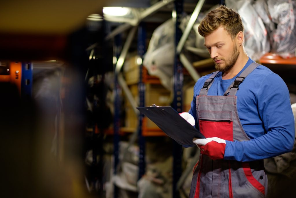 Worker in a automotive spare parts warehouse